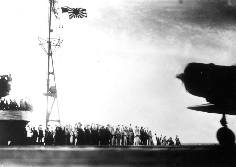 "This photograph, from a Japanese film later captured by American forces, is taken aboard the Japanese aircraft carrier Zuikaku, just as a Nakajima ""Kate"" B-5N bomber is launching off deck for the second wave of the attack on Pearl Harbor, Hawaii, on December 7, 1941. Photo: AP Photo / AP1941"