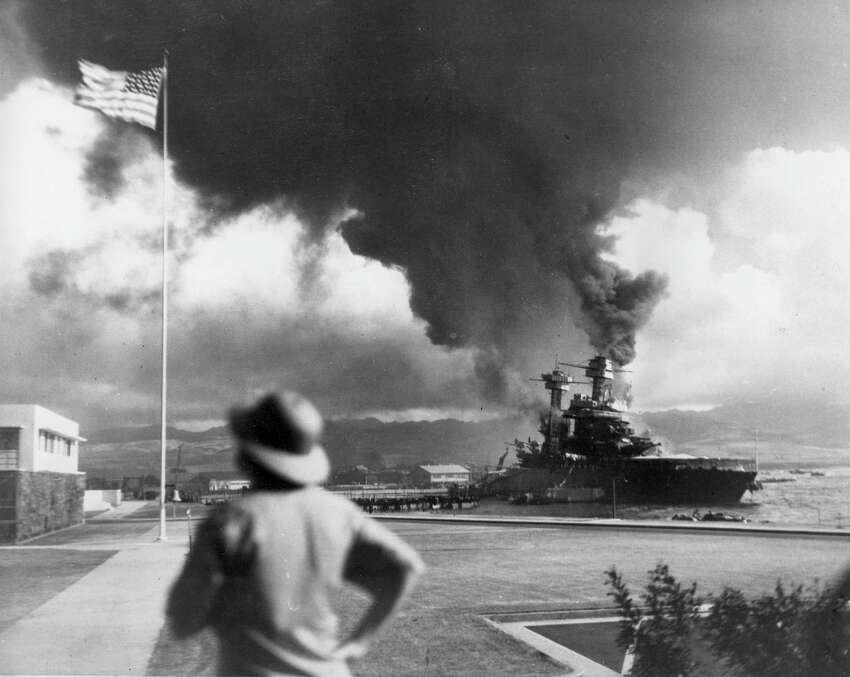 American ships burn during the Japanese attack on Pearl Harbor, Hawaii, on Dec. 7, 1942.