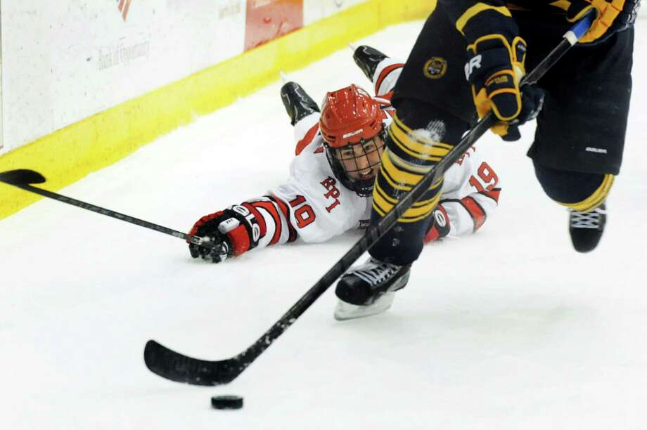 RPI's Mike Zalewski, left, tries to swipe away the puck during their hockey game against Quinnipiac on Friday, Dec. 6, 2013, at Rensselaer Polytechnic Institute in Troy, N.Y. (Cindy Schultz / Times Union) Photo: Cindy Schultz / 00024882A