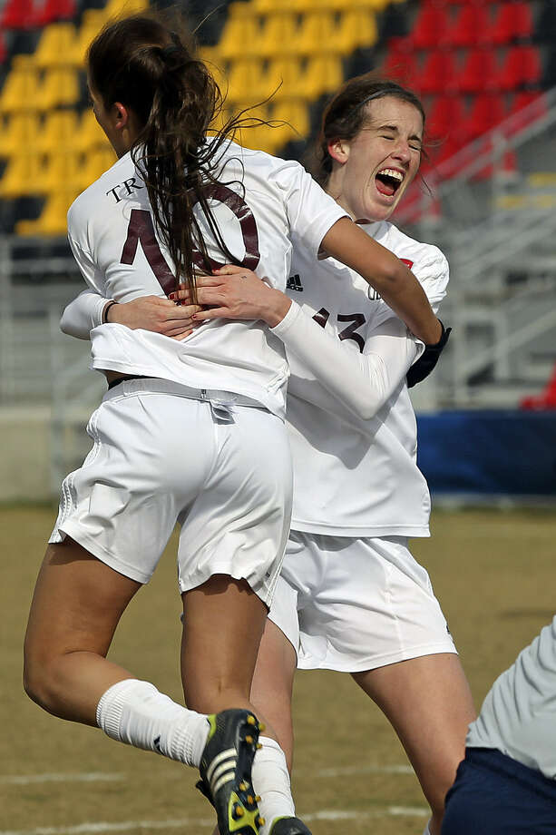 Trinity midfielders Michelle Lanier (right) and Emily Jorgens celebrate after Lanier punched in the Tigers' first goal. Photo: Tom Reel / San Antonio Express-News