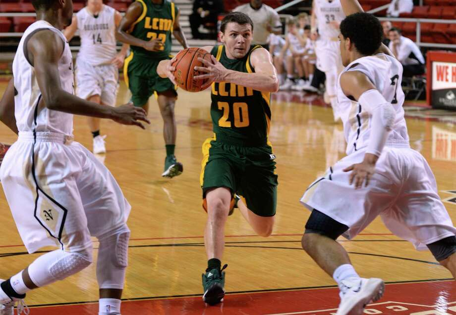 Little Cypress-Mauriceville's Taylor Peveto drives the ball against Nederland during the YMBL Basketball tournament at Lamar on Friday. Photo taken Friday, December 06, 2013 Guiseppe Barranco/@spotnewsshooter Photo: Guiseppe Barranco, Photo Editor