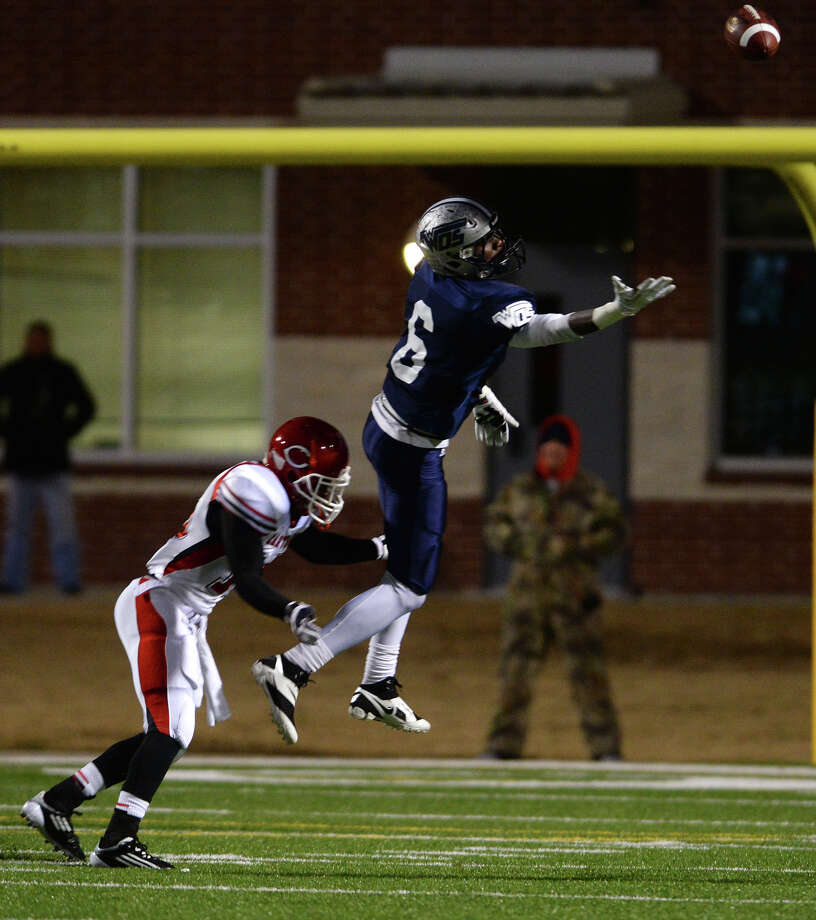 "West Orange-Stark's Deionte' Thompson, No. 6, finds that a pass is out of reach as Carthage's Christian Allison, No. 16, pulls him down during Friday night's game. West Orange-Stark High School played against Carthage High School at the Carroll A. ""Butch"" Thomas Stadium on Friday night. Photo taken Jake Daniels/@JakeD_in_SETX Photo: Jake Daniels / ©2013 The Beaumont Enterprise/Jake Daniels"