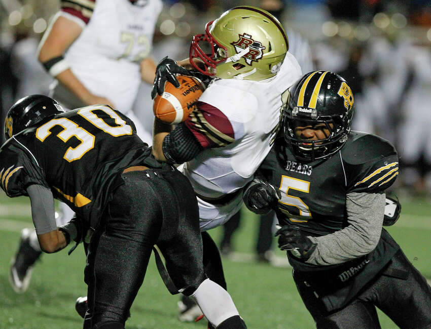 Brennan's D.J. Allen (right) and Christian Dillard combine to bring down Leander Rouse quarterback Billy Ray McCrary during the third quarter of their Class 4A Division I state quarterfinal game at Comalander Stadium on Friday, Dec. 6, 2013. Brennan beat Rouse 30-7. MARVIN PFEIFFER/ mpfeiffer@express-news.net