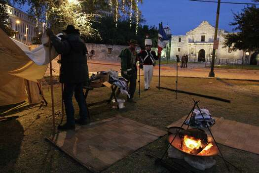 Members of the San Antonio Living History Association set up camp in  Alamo Plaza for a battle re-enactment earlier this month. It is  imperative that as much as possible of the original footprint of the  Alamo be restored under a single ownership to tell the complete story of  what happened here in 1836. Photo: File Photo, San Antonio Express-News