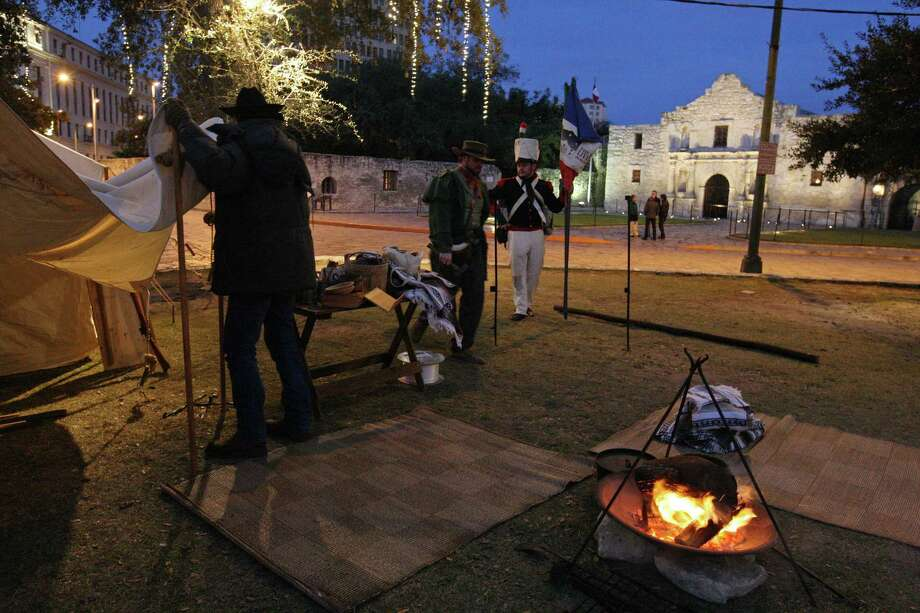 San Antonio Living History Association members set up in Alamo Plaza this month. It is imperative that as much as possible of the original footprint of the Alamo be restored under a single ownership to tell the fulll story of what happened in 1836. Photo: File Photo, San Antonio Express-News