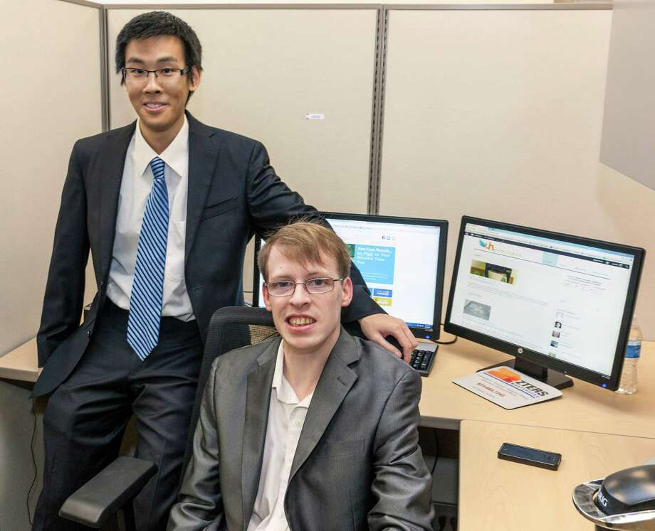 Justin Farley, seated, and Derek Yeung sell items on their website, unlimiters.com, to help people overcome limitations. Photo: Craig Hartley, Freelance / Copyright: Craig H. Hartley