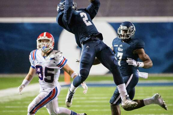 Rice safety Malcolm Hill, center, is part of an improved defensive unit that more than carried its weight en route to the Owls finding themselves in the Conference USA Championship Game at Rice Stadium.