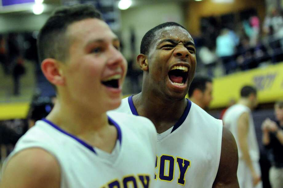 Troy's Zach Radz, left, and Justice Walston celebrate their 59-48 win against CBA during their basketball game on Friday, Dec. 6, 2013, at Troy High in Troy, N.Y. (Cindy Schultz / Times Union) Photo: Cindy Schultz / 00024920A