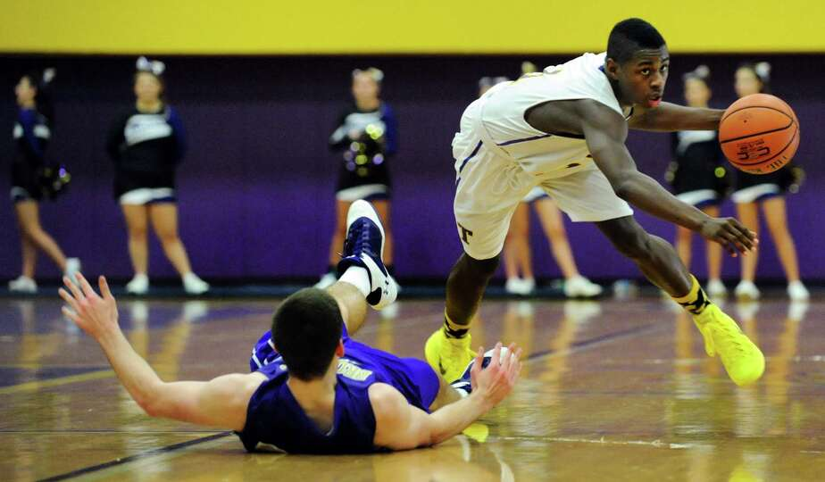 Troy's Dyaire Holt, right, clears a tangle with CBA's Greig Stire during their basketball game on Fr
