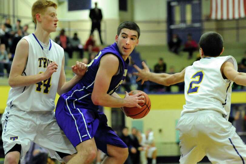 CBA's Greig Stire, center, looks for room as Troy's Jack McLaren, left, and Ryan Carmello defend dur