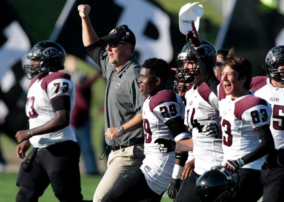 Pearland coach Tony Heath celebrates with the team after they beat Lamar 21-13 at Mercer Stadium on Nov. 29. Photo: J. Patric Schneider, Freelance / © 2013 Houston Chronicle