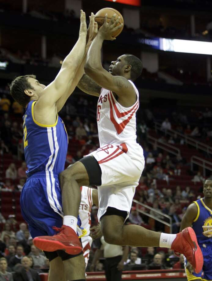 Dec. 6: Rockets 105, Warriors 83  Terrance Jones works to shoot over Andrew Bogut. Photo: Melissa Phillip, Houston Chronicle