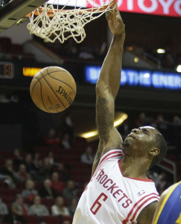 Terrance Jones dunks. Photo: Melissa Phillip, Houston Chronicle