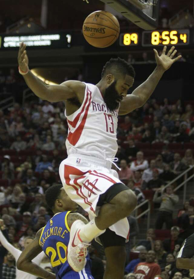 James Harden celebrates after dunking. Photo: Melissa Phillip, Houston Chronicle