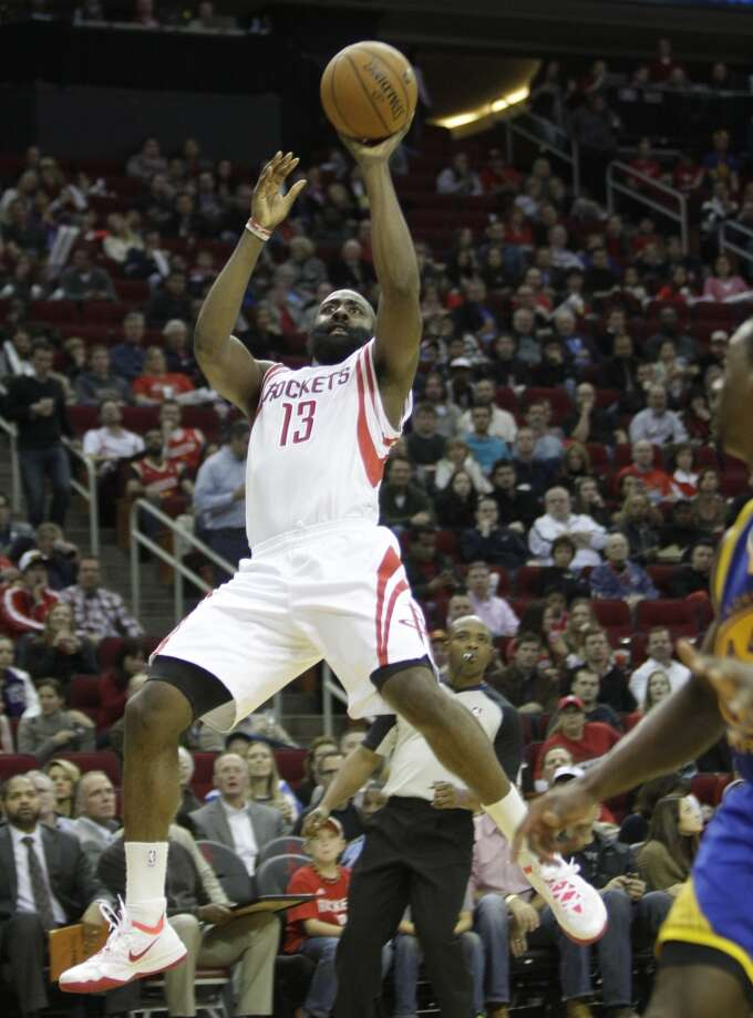 James Harden shoots against Golden State. Photo: Melissa Phillip, Houston Chronicle