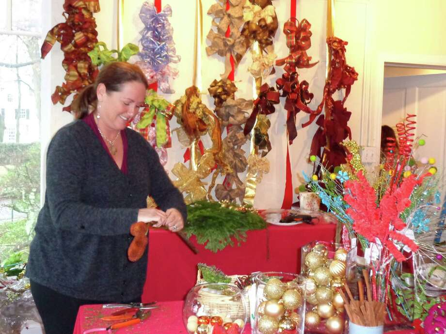 Beth Foldesi made and decorated holiday wreaths during the Fairfield Christmas Tree Festival. Photo: Meg Barone / Fairfield Citizen contributed