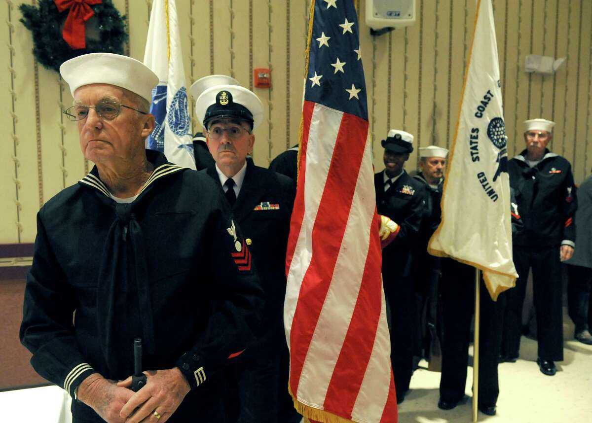 Navy veterans Larry Williams, left, and Art Dot lead the USS Slater Color Guard during a Pearl Harbor Day Memorial Observance at the Zalonga American Legion Post on Saturday Dec. 7, 2013 in Albany, N.Y. (Michael P. Farrell/Times Union)
