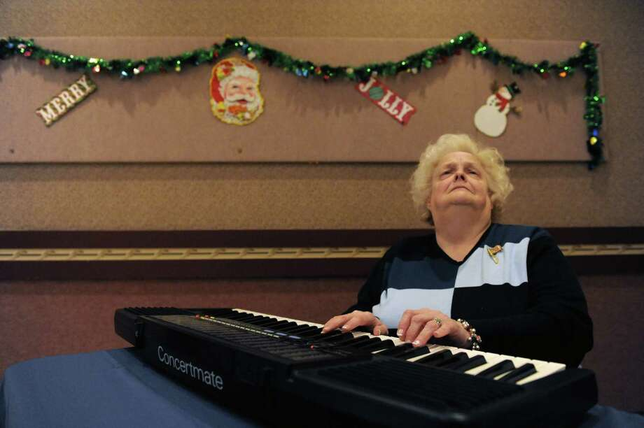Cathy Dorn plays patriotic music during a Pearl Harbor Day Memorial Observance at the Zalonga American Legion Post on Saturday Dec. 7, 2013 in Albany, N.Y. (Michael P. Farrell/Times Union) Photo: Michael P. Farrell / 00024956A