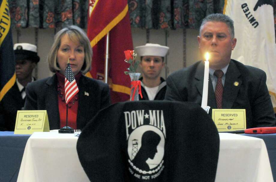 Rensselaer County Executive Kathleen M. Jimino, left, and Assembly Member John McDonald the POW-MIA Table ceremony  during a Pearl Harbor Day Memorial Observance at the Zalonga American Legion Post on Saturday Dec. 7, 2013 in Albany, N.Y. (Michael P. Farrell/Times Union) Photo: Michael P. Farrell / 00024956A