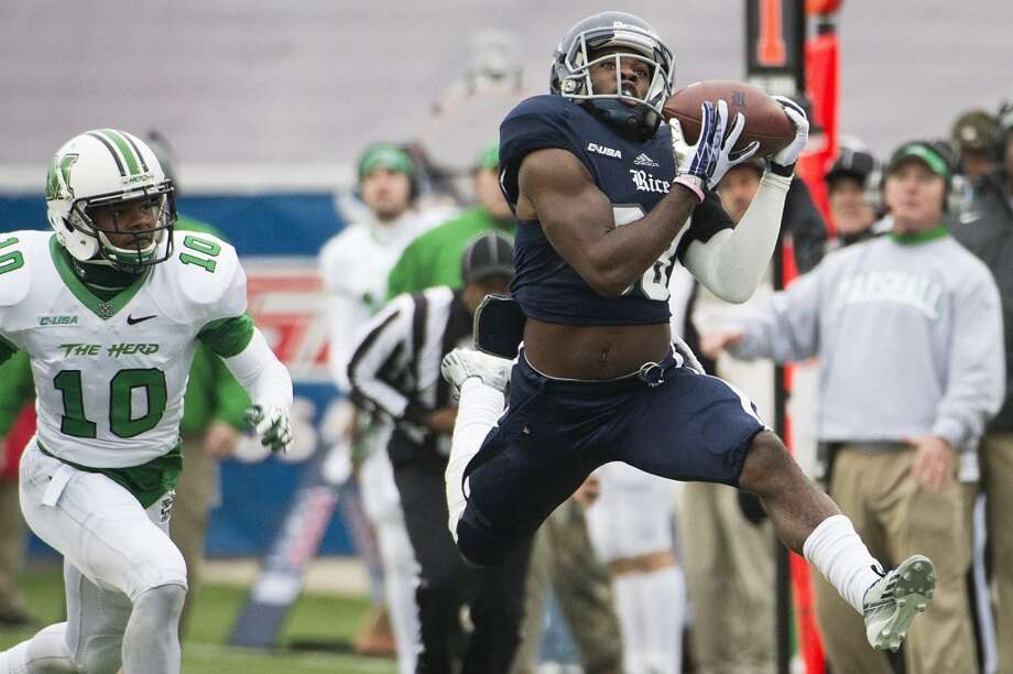 Darrion Pollard of Rice makes a reception against Marshall. Photo: Smiley N. Pool, Houston Chronicle