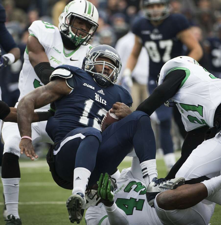 Rice running back Charles Ross is tackled against Marshall. Photo: Smiley N. Pool, Houston Chronicle