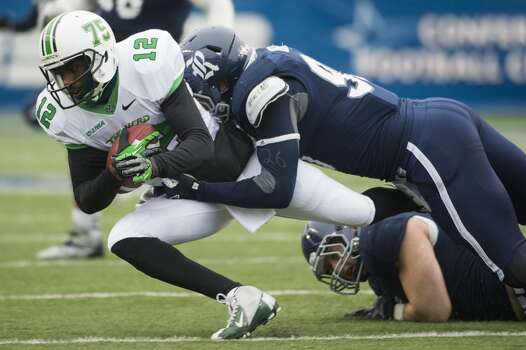 Cody Bauer of the Owls sacks Marshall quarterback Rakeem Cato. Photo: Smiley N. Pool, Houston Chronicle
