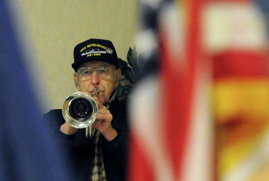 Korean War Navy veteran Richard Bender plays taps during a Pearl Harbor Remembrance at the Melvin Roads American Legion Post 1231 on Saturday Dec. 7, 2013 in East Greenbush, N.Y. (Michael P. Farrell/Times Union) Photo: Michael P. Farrell / 00024776A