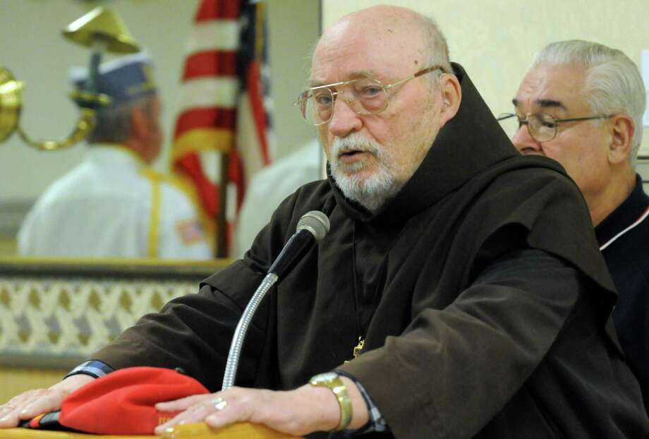 Korean War Marine veteran Brother Robert Francis Mattews gives the invocation during a Pearl Harbor Remembrance at the Melvin Roads American Legion Post 1231 on Saturday Dec. 7, 2013 in East Greenbush, N.Y. (Michael P. Farrell/Times Union) Photo: Michael P. Farrell / 00024776A