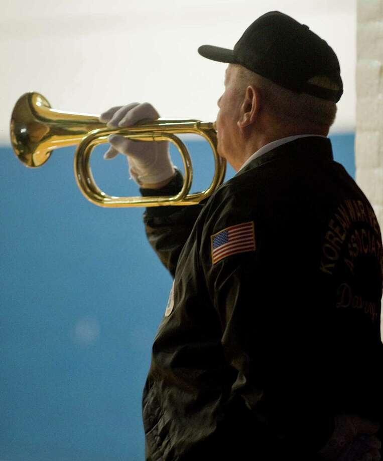 Korean War veteran Ken Post plays Taps during the Pearl Harbor Memorial Service at the War Memorial building in Rogers Park. Saturday, Dec. 7, 2013 Photo: Scott Mullin / The News-Times Freelance