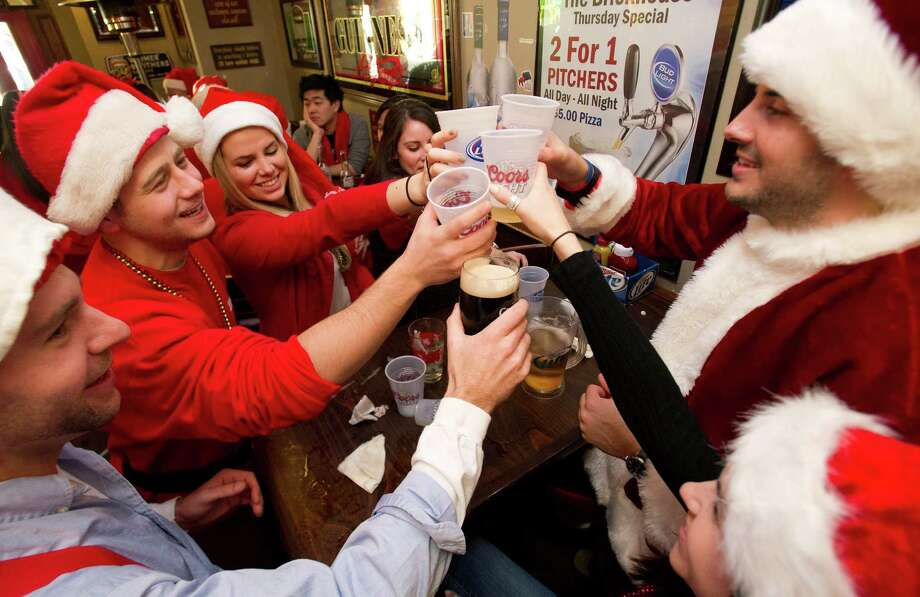 Clockwise from right, Mike Welch, Caitlin Grogan, Corey Mitchell, Jonathan Arkins, Jill Longo and Sarah Niez drink at Brickhouse Bar and Grill during SantaCon in Stamford, Conn., on Saturday, December 7, 2013. Photo: Lindsay Perry / Stamford Advocate