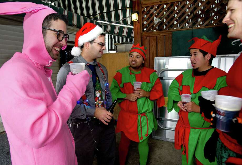 From left, Paul Heinrich, Mike Giaquinto, Caleb Gaston, and Jeremiah Gaston drink at Murphy's during SantaCon in Stamford, Conn., on Saturday, December 7, 2013. Photo: Lindsay Perry / Stamford Advocate
