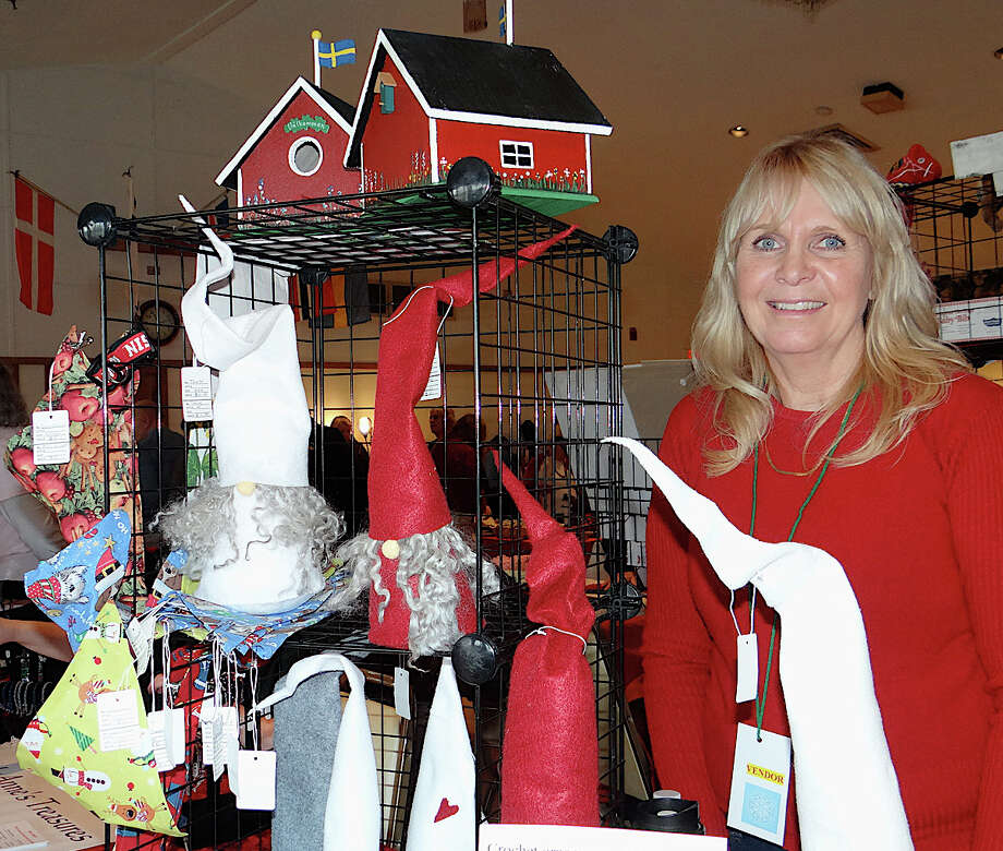 Lillian Nordstrom displays handmade seasonal crafts at the Scandinavian Club's holiday sale. Photo: Mike Lauterborn / Fairfield Citizen contributed
