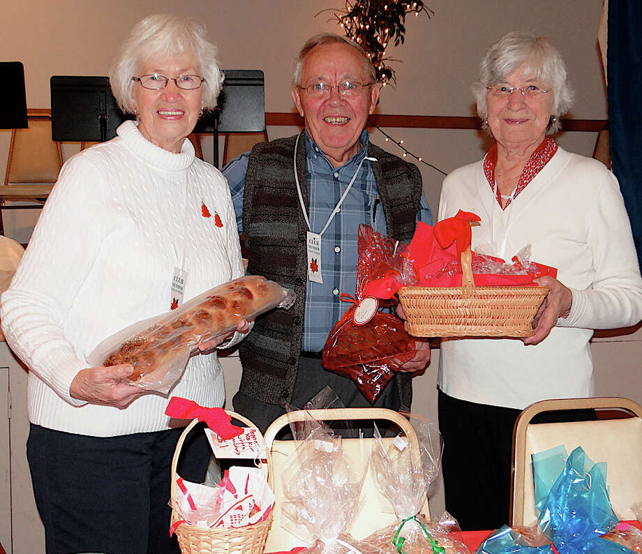 Dorothy Grannas, Erik Nix and MajBritt Nix offer traditional baked goods at the Scandinavian Club's holiday fair. Photo: Mike Lauterborn / Fairfield Citizen contributed