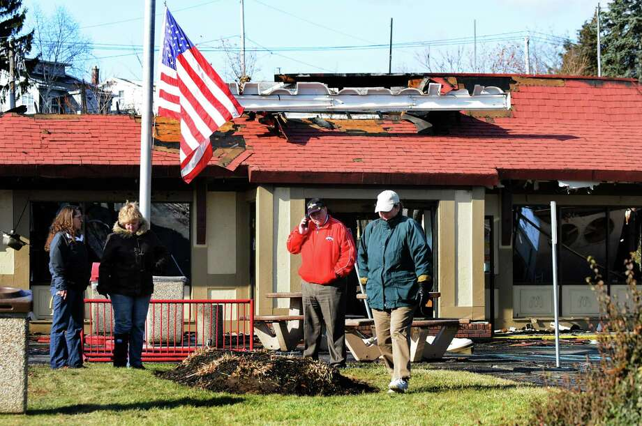 Roger Grant, center, owner of this McDonald's, is on the scene of the fire that destroyed his restaurant on Saturday, Dec. 7, 2013, in Waterford, N.Y. (Cindy Schultz / Times Union) Photo: Cindy Schultz