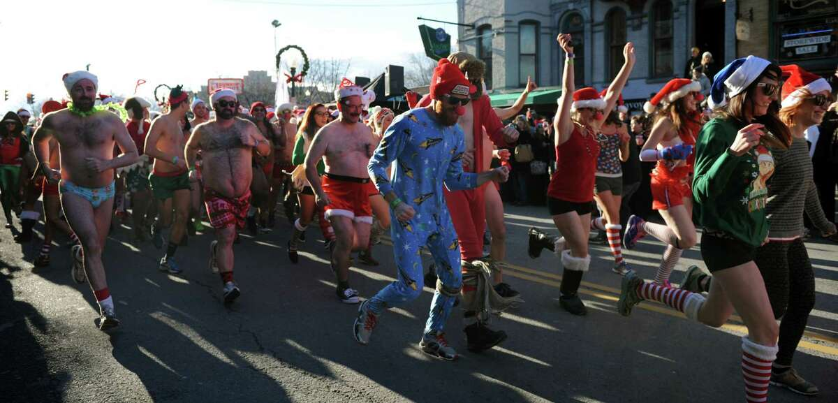 Runners take off for the Santa Speedo Sprint down Lark Street on Saturday, Dec. 7, 2013, in Albany, N.Y. The 8th annual event benefits the Albany Damien Center and the HIV/AIDS program at Albany Medical Center. (Cindy Schultz / Times Union)