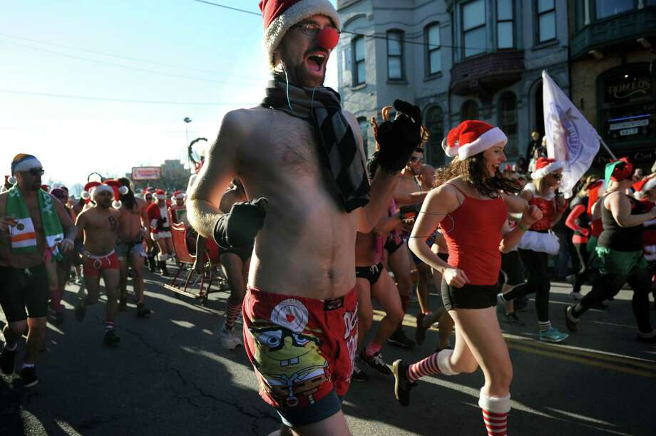Runners take off for the Santa Speedo Sprint down Lark Street on Saturday, Dec. 7, 2013, in Albany, N.Y. The 8th annual event benefits the Albany Damien Center and the HIV/AIDS program at Albany Medical Center. (Cindy Schultz / Times Union) Photo: Cindy Schultz / 00024885A