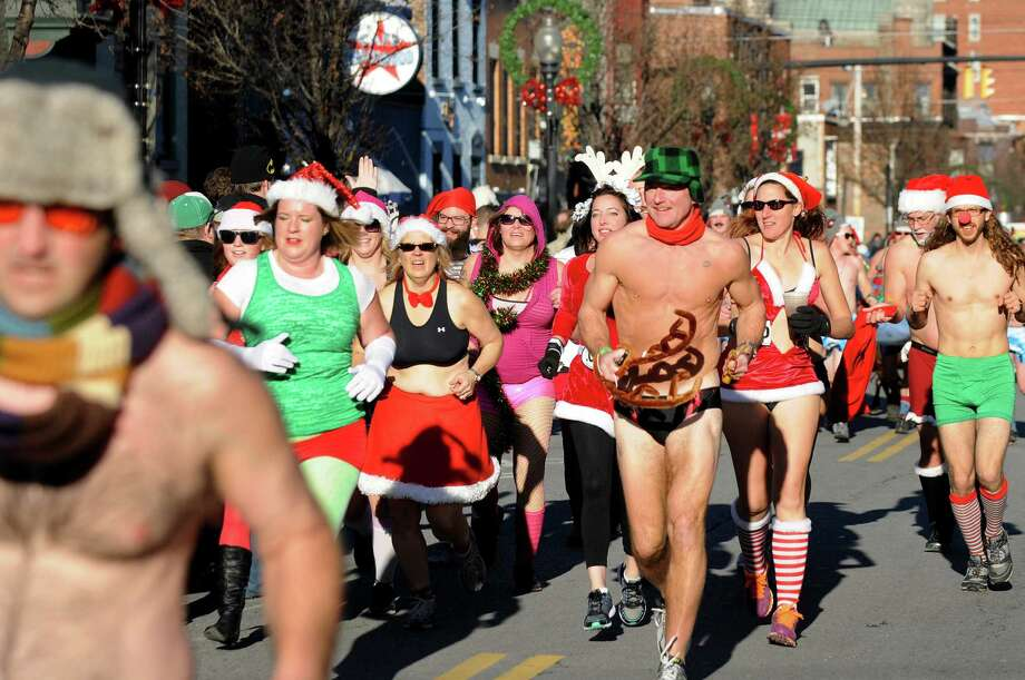 Runners approach the finish line of the Santa Speedo Sprint on Lark Street on Saturday, Dec. 7, 2013, in Albany, N.Y. The 8th annual event benefits the Albany Damien Center and the HIV/AIDS program at Albany Medical Center. (Cindy Schultz / Times Union) Photo: Cindy Schultz / 00024885A