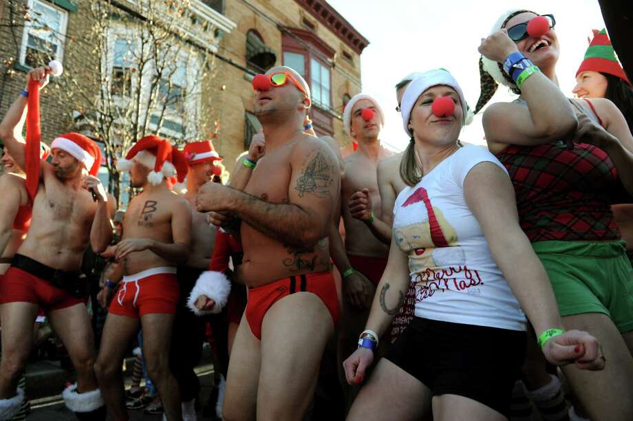 Runners groove to the music at the starting line of the Santa Speedo Sprint on Lark Street on Saturday, Dec. 7, 2013, in Albany, N.Y. The 8th annual event benefits the Albany Damien Center and the HIV/AIDS program at Albany Medical Center. (Cindy Schultz / Times Union) Photo: Cindy Schultz / 00024885A