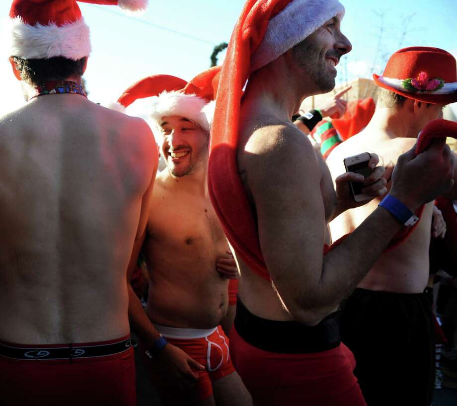 Participants prepare for the Santa Speedo Sprint on Lark Street on Saturday, Dec. 7, 2013, in Albany, N.Y. The 8th annual event benefits the Albany Damien Center and the HIV/AIDS program at Albany Medical Center. (Cindy Schultz / Times Union) Photo: Cindy Schultz / 00024885A