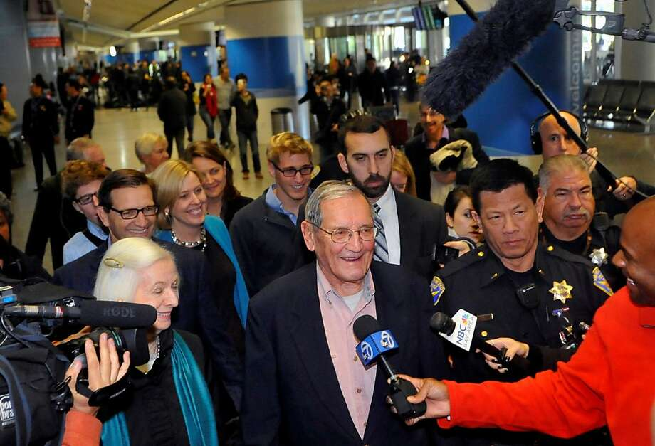 Merrill Newman of Palo Alto, who was detained for a month in North Korea after visiting, is welcomed at SFO. Photo: Josh Edelson, Special To The Chronicle