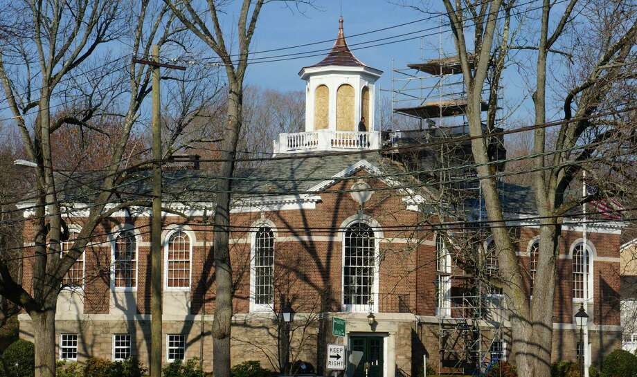 Work is underway to restore the cupola atop Perrot Memorial Library. Photo: Paul Schott, Greenwich Time / Greenwich Time