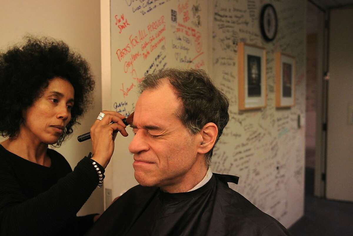 Ron Unz gets hair and makeup from freelance makeup artist Kadidja Sallak in the green room before participating in a live televised discussion about minimum wage with host Thuy Vu and guest Ken Jacobs, Chair with the Center for Labor Research and Education for the Institute for Research on Labor and Employment December 6, 2013 at the KQED building in San Francisco, Calif.