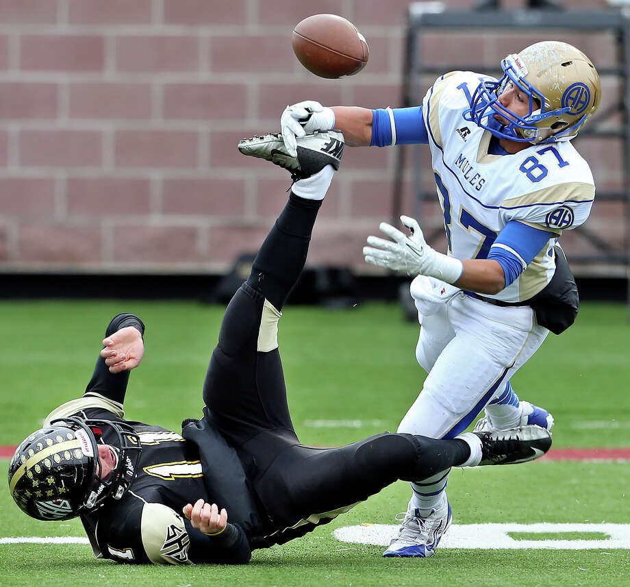A pass to Mule receiver Christian Lalinde is broken up by Sandcrab defender Travis Hudson as Alamo Heights plays Calhoun at Bobcat Stadium in the 4A quarterfinals on December 7, 2013. Photo: Tom Reel, San Antonio Express-News
