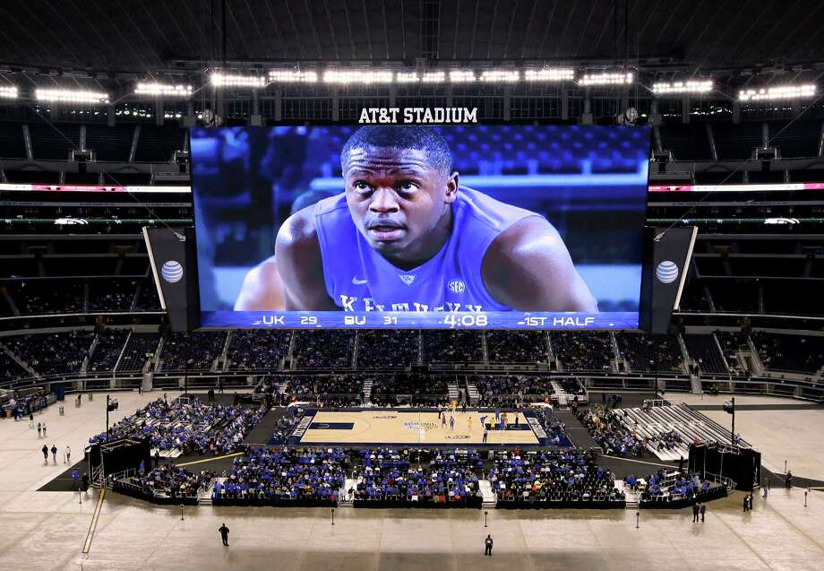 The video screen image of Kentucky forward Julius Randle looms large over the small crowd that made it to a men's and women's doubleheader Friday night. Photo: Tony Gutierrez, STF / AP