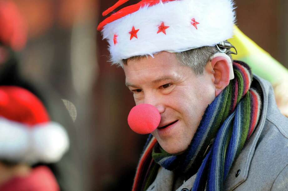 Steven Bernstein of Albany wears a festive hat and nose to cheer on runners in the Santa Speedo Sprint on Saturday, Dec. 7, 2013, in Albany, N.Y. (Cindy Schultz / Times Union) Photo: Cindy Schultz / 00024885A