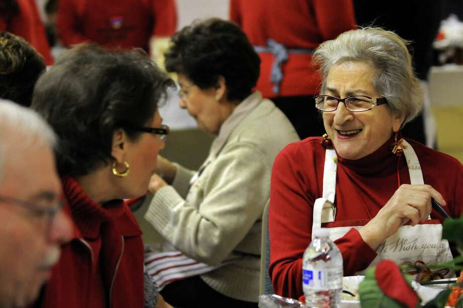 Lucy Morton, right, of the Women's Guild at St. Peter's Armenian Church, enjoys friends and a meal before her volunteer shift during the annual Holiday Bazaar on Saturday, Dec. 7, 2013, at St. Petera€™s Armenian Church in Watervliet, N.Y. The fundraising event, which features traditional Armenian foods and baked goods, crafts and music, continues Sunday from 12 to 4 p.m. (Cindy Schultz / Times Union) Photo: Cindy Schultz / 00024874A