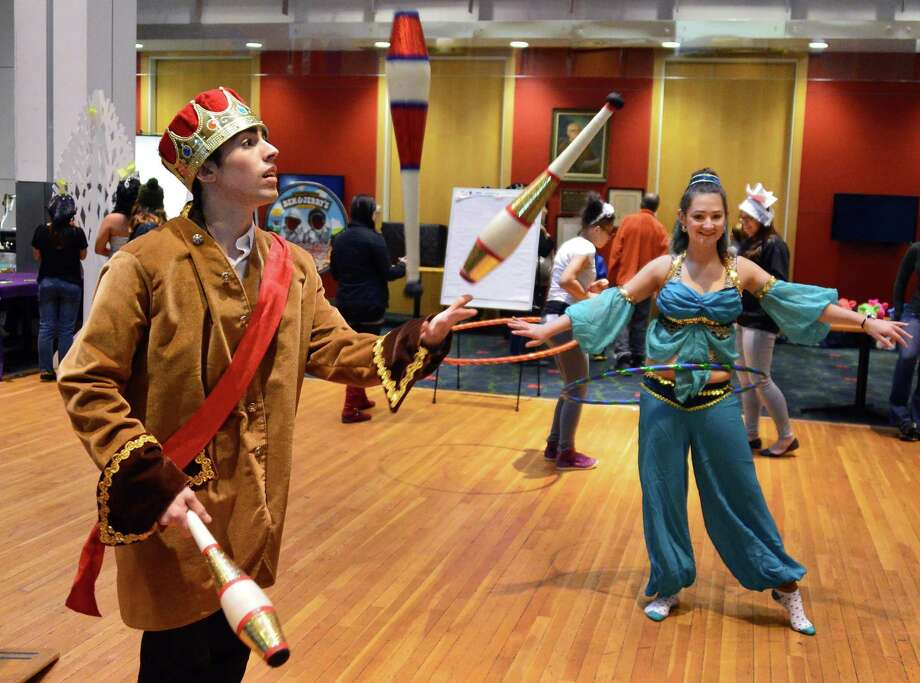 RPI student Josh Jacobson, left, and Katherine Crandall, in costume as Princess Jasmine at RPI's Eco Princess Festival in the RPI Student Union Saturday Dec. 7, 2013, in Troy, NY. The purpose of the event is to teach young children that being a princess (or a prince) is not about beauty and popularity, but rather about caring for the community and being smart.  (John Carl D'Annibale / Times Union) Photo: John Carl D'Annibale / 00024857A