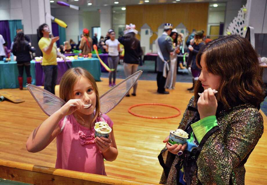 Sisters Jodie, 7, left, and Kimberly Howland, 9, of Westerlo enjoy their ice cream in costume at RPI's Eco Princess Festival in the RPI Student Union Saturday Dec. 7, 2013, in Troy, NY. The purpose of the event is to teach young children that being a princess (or a prince) is not about beauty and popularity, but rather about caring for the community and being smart.  (John Carl D'Annibale / Times Union) Photo: John Carl D'Annibale / 00024857A