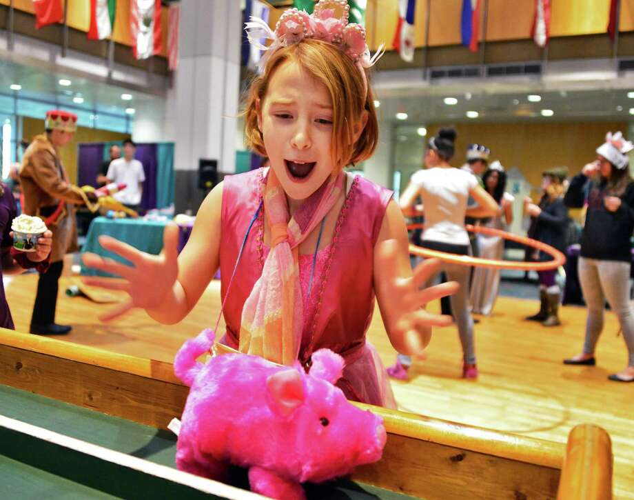 Madyson Moss, 9, of Brunswick cheers on her entry in the pig race at RPI's Eco Princess Festival in the RPI Student Union Saturday Dec. 7, 2013, in Troy, NY. The purpose of the event is to teach young children that being a princess (or a prince) is not about beauty and popularity, but rather about caring for the community and being smart.  (John Carl D'Annibale / Times Union) Photo: John Carl D'Annibale / 00024857A