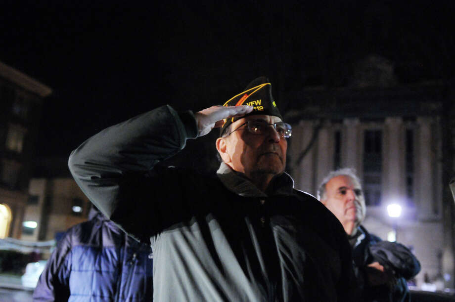 Army Veteran Anthony M. Marzullo salutes during the Pledge of Allegiance as the Greenwich Legion Post 29 recognize the anniversary of the attack on Pearl Harbor at the war memorial on Greenwich Avenue in Greenwich, Conn., Dec. 7, 2013. Photo: Keelin Daly / Stamford Advocate Freelance